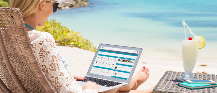 header image of lady working on laptop at the beach